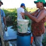 Demonstração da preparação da solução composta de melaço, água e microorganismos eficazes